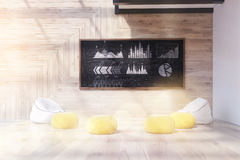Chalkboard with graphs. Chalkboard with company's stats in modern office. Pillows and armchairs on floor. Concept of data analysis. 3d rendering. Toned image Royalty Free Stock Photography