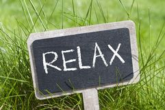 Chalkboard in the grass with relax royalty free stock photos
