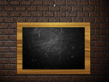 Chalkboard hang on brick wall Royalty Free Stock Image
