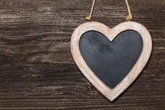 Chalkboard heart on wooden board Stock Photos