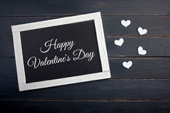 Chalkboard with hearts on wood background. Valentine`s day card Royalty Free Stock Photo