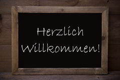 Chalkboard With Herzlich Willkommen Means Welcome royalty free stock photos