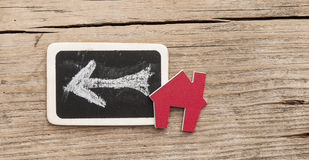 Chalkboard with house shaped sign Royalty Free Stock Image