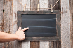 Chalkboard. Human hand pointing on blackboard. Stock Photos