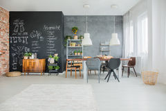Chalkboard kitchen decor. In open spacious dining room Royalty Free Stock Photography
