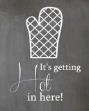 Chalkboard kitchen Humor Poster Oven Mitt. A chalkboard kitchen humor poster, Oven Mitt it' getting Hot in here Stock Images