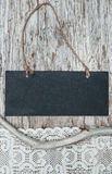 Chalkboard with lacy fabric and dry branch on old wood Stock Photo