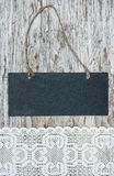 Chalkboard with lacy fabric on the old wood Stock Photography