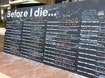 Chalkboard Last Wish Bucket Items. As a social experiment, an outdoor chalkboard displays last wish bucket items from anonymous patrons at Lake Anne Plaza in Stock Photography