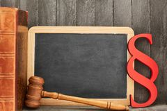 Chalkboard law book and paragraph as law concept. Chalkboard law gavel and paragraph as law concept royalty free stock photography