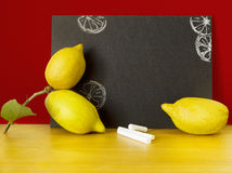 Chalkboard with lemons for summer menu Stock Photography