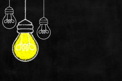 Chalkboard with Light Bulb. Royalty Free Stock Photos