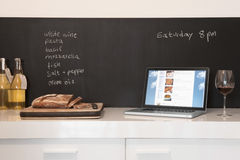 Chalkboard List With Cut Bread And Laptop Stock Photo