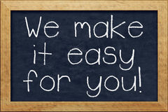 Chalkboard we make it easy for you Royalty Free Stock Photo