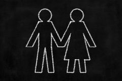 Chalkboard with Man and Woman Drawing Holding Hand. Royalty Free Stock Photography