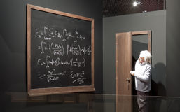 Chalkboard with math formulas and Einstein model. Stock Photo