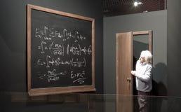 Chalkboard with math formulas and Einstein model. Stock Photo