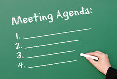 Chalkboard meeting agenda. Meeting agenda and outline on a green chalkboard Royalty Free Stock Photography