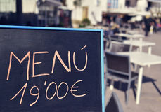 Chalkboard menu in a terrace somewhere in Spain. Closeup of the chalkboard in a terrace of a restaurant somewhere in Spain, where you can read menu 19,90 euros stock photo