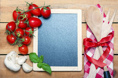 Chalkboard menu on a wooden background Royalty Free Stock Photography