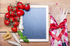 Chalkboard menu on a wooden background Royalty Free Stock Photo