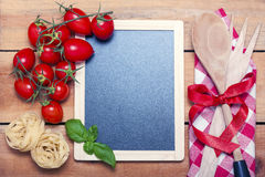 Chalkboard menu on a wooden background Stock Photos