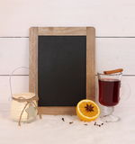 Chalkboard, mulled wine, orange, spice and candle Stock Images