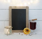 Chalkboard, mulled wine, orange, spice and wire lights Royalty Free Stock Image