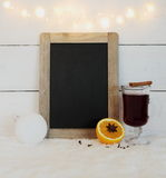 Chalkboard, mulled wine, orange and wire lights Royalty Free Stock Image