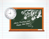 Chalkboard on the notebook page. Christmas school royalty free stock image