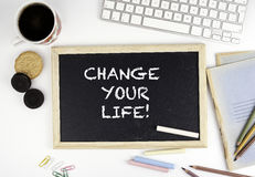 Chalkboard on office desk with text: Change your Life Royalty Free Stock Photo