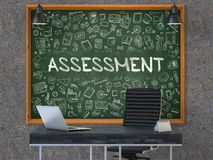 Chalkboard on the Office Wall with Assessment Concept. 3D. stock image