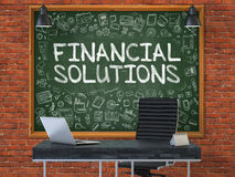 Chalkboard on the Office Wall with Financial Solutions Concept. 3D. Green Chalkboard on the Red Brick Wall in the Interior of a Modern Office with Hand Drawn Royalty Free Stock Image