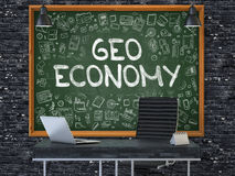 Chalkboard on the Office Wall with Geo Economy Concept. 3D. Stock Photos