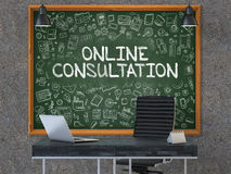 Chalkboard on the Office Wall with Online Consultation Concept. 3D. Green Chalkboard on the Dark Old Concrete Wall in the Interior of a Modern Office with Hand Stock Photos