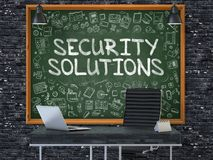 Chalkboard on the Office Wall with Security Solutions. 3d. Stock Photos