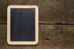 Chalkboard on old wood Royalty Free Stock Images