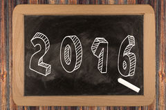 2016 - chalkboard. With outlined text - on wood Royalty Free Stock Image
