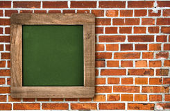 Chalkboard over red brick wall background Royalty Free Stock Photography
