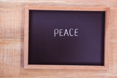 Chalkboard with peace text Royalty Free Stock Images