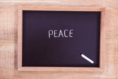 Chalkboard with peace text Stock Photos