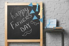 Chalkboard with phrase. `Happy father`s day` on brick wall background Stock Photography
