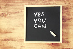 Chalkboard with the phrase yes you can. Written on it. room for text Royalty Free Stock Photos