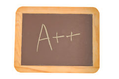 Chalkboard with an A plus plus written on it Stock Photo
