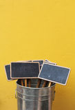 Chalkboard in the pot on yellow background Royalty Free Stock Image