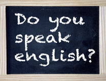 Chalkboard with the question Do you speak english Royalty Free Stock Photo