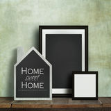 Chalkboard with quote and frames on table Royalty Free Stock Photos