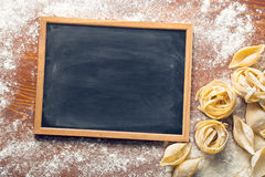 Chalkboard and raw pasta Stock Images