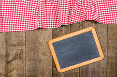 Chalkboard with red checked cloth Royalty Free Stock Photos