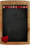 Chalkboard Red Gingham Love Valentine's hearts hanging on wooden Stock Image
